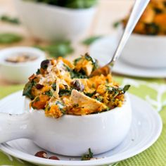 Pieces of shredded chicken in a mash of roasted butternut squash and wilted spinach with a hint of coconut milk and toasted hazelnuts.