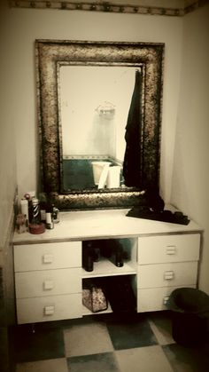 A White Dressing Table with a Golden frame mirror with a White Marble top