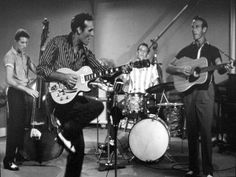 "Carl Perkins (2nd from left) performing ""Glad All Over"" with (left-right) Clayton Perkins, W.S. ""Fluke"" Holland, and Jay Perkins in the movie Jamboree."