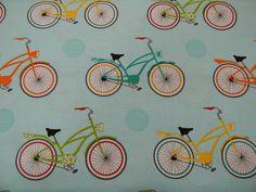 Cruzin Fabric Bikes on Blue by Barbara Jones of Quilt Soup. $9.60, via Etsy.