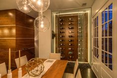 A glass enclosed cellar with an exquisite display make this wine cellar a piece of art. Seen in Gramercy, an Atlanta community. Wine Display, Wine Wall, Dining Room Design, Dining Rooms, New Home Communities, Atlanta Homes, Wet Bars, Tasting Room, New Homes For Sale