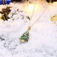 Are you looking for a long lasting jewelry piece that will contain the magic of Christmas for years to come? Then this is what you've been looking for. A classic and detailed necklace that sparkles all day with its 18K gold shine! Christmas Tree Necklace, Arrow Necklace, Pendant Necklace, Tree Pendant, White Gift Boxes, Gold Plated Necklace, Perfect Christmas Gifts, Stone Pendants, Gifts For Women