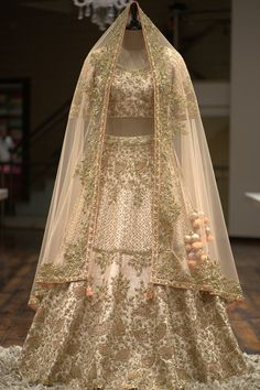 Light Beige Raw Silk Sequins Embroidered Bridal – Stylizone A beautiful blush pink gown with a heavily embellished bodice in pearls, beads, and sequins on the front and back. The gown has an irregular pearl spray, highlighting the outfit.