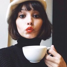 Dark brown short bob with fringe. It really is the classic haircut, from any decade from the 1920s on. Taylor Lashae #pixiemarket: