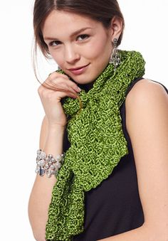 Begin with a few chains and employ a series of clever increases and decreases to create a scarf on the bias. Shown in Patons Metallic. #crochet