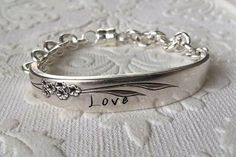 """Our charming vintage silverware bracelets are individually handcrafted and hand-stamped words of inspiration. This vintage silverware bracelet features the word """"Love"""" and is made from a single vintage Silver Spoon Jewelry, Fork Jewelry, Silverware Jewelry, Metal Jewelry, Custom Jewelry, Jewelry Art, Vintage Jewelry, Jewelry Design, Vintage Silver"""