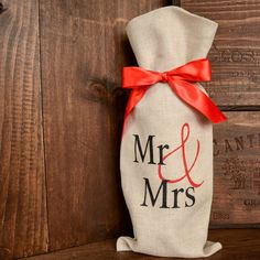 A personal favorite from my Etsy shop https://www.etsy.com/listing/499676798/linen-mr-mrs-wine-gift-bag-with-red