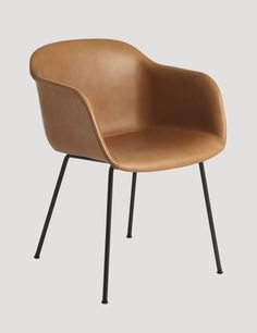 The FIBER ARMCHAIR has been designed to balance maximum comfort with minimum space. The chair has been produced from an innovative bio-composite material that includes 25% wood fibres. Here in slik Cognac leather. Designed by Iskos-Berlin #muuto #muutodesign