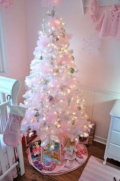 #XmasPinkRoom love the pink rug on the floor as well as the walls and the hanging rack.