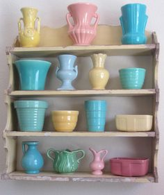 Some of my vintage pottery displayed on a perfectly shabby yellow shelf