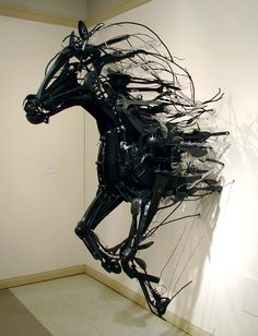 Absolutely amazing! Upcycling art - if you look close, you'll see that it's all spatulas and other cutlery