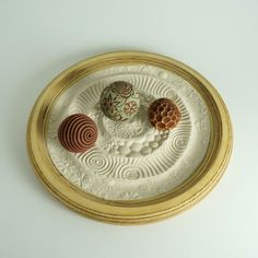 Mini Zen Garden for Sand Play. Hands-on sand play for the tabletop. Create sand textures by rolling the balls in the sand to create sand patterns. Perfect beach house decor idea!
