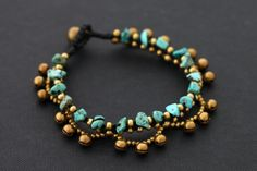 This is hand woven bracelet made with dark brown cotton waxed cord weaved together with Turquoise ,brass beads,chain and brass jingling bell. Closure
