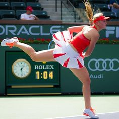 Nice Nike outfit action photo of Carina Witthoeft #BNPPO16 #flyingskirt #flyinghair #niketennis
