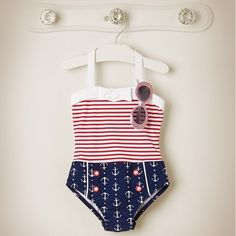 Our all-American one-piece features striped and anchor print color blocks.