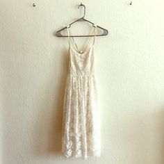 Abercrombie & Fitch Midi Lace Dress Adorable lace dress by Abercrombie & Fitch, fully lined. Straps run through back and tie, so it is fully adjustable based on how high, low, or open you want the bodice to be. Off white in color. NWOT Never worn Abercrombie & Fitch Dresses Midi