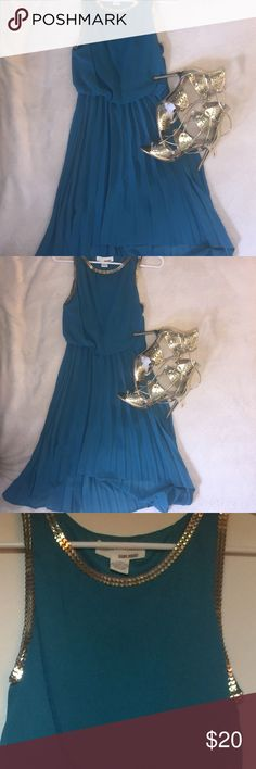 NWT Teal hi low dress with gold detailing This is a NWT teal hi low Dress with gold embellishments around the neck and arm opening. Such s great dress for a summer wedding or date night. No rips, stains, or flaws. Sans Souci Dresses High Low