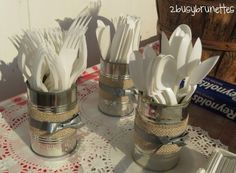 Recycled tin cans are a rustic way to provide silverware.
