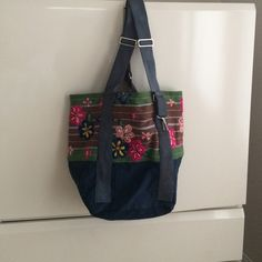 Free People Bag Gorgeous Free People Tote. Never used. Cotton/Canvas material with embroidered flowers. 15✖️20✖️18. Adjustable straps. Great bag Free People Bags Totes