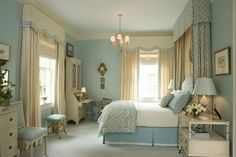 cream drapes, soft blue prints, chandy, blue lampshades
