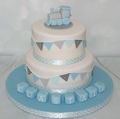 This is such a sweet baby shower cake! I love the train topper!