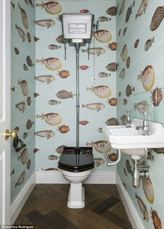 smallest room can be stylish Fishbowl: A cloakroom design by Grand Design London featuring Cole and Son's Fornasetti wa.Fishbowl: A cloakroom design by Grand Design London featuring Cole and Son's Fornasetti wa. Wallpaper Toilet, Small Bathroom Wallpaper, Fish Wallpaper, Wall Paper Bathroom, Funky Bathroom, Wallpaper Ideas, Cloakroom Wallpaper, Quirky Wallpaper, Wood Effect Wallpaper