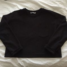 T by Alexander Wang Cropped Sweatshirt On trend! Basic black cropped sweatshirt with a single chest pocket. Long sleeves. Crew neck. Like new. T by Alexander Wang Tops Sweatshirts & Hoodies