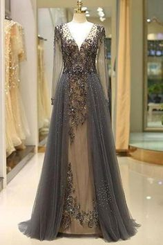 Shop our beautiful collection of unique and convertible long Prom dresses from FabFba,offers long bridesmaid dresses for women online.Elegant A Line V Neck Long Sleeves Tulle Grey Prom Dresses uk with Beading Grey Prom Dress, Prom Dresses Uk, Beaded Prom Dress, Prom Dresses With Sleeves, Long Bridesmaid Dresses, Dress Long, A Line Evening Dress, Formal Evening Dresses, Formal Gowns