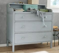 Jacqueline Dresser  Add eclectic charm to the bedroom with this vintage-style dresser, designed after a flea market find. The semigloss blue-gray finish pairs beautifully with our metal and upholstered beds and is edge-rubbed to reveal hints of the bare wood below.