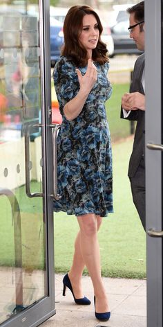 Kate Middleton is having fun re-wearing her favorite maternity outfits. This time, the Duchess of Cambridge recycled a Seraphine floral dress ($109; seraphine.com) and paired it with navy pumps.