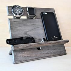 This Simple Docking Station was created so that you can keep several things at one place: cell phone, wallet, watch, keys, jewelry, accessories, and other small items. Item Features: •Cut out at the top where you can hang your key-chain, bracelets, watches, and necklaces. (can fit up to 3 watche