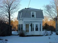 This sweet, tiny mansard roof house is about 15 minutes away in Round Pond, Maine.