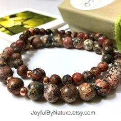 """Natural leopard skin jasper with """"sparks"""" of copper. An earthy, handmade style for men, women, teens. ________ •Choice of 2 styles - 8mm or 6mm beads •A great couple's set •Custom-sized for a great fit •Gift-ready packaging with original-design gift card"""
