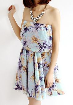 Floral Strapless Chiffon Dress. This flowy strapless dress features a billowy chiffon fabrication, an elasticized top, and an elastic waist for a little definition.