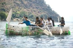 Recycled-Bottle Boat - Sometimes the utility of a used lightweight container is immediate. Pictured: A group of men paddle a boat made of plastic bottles, on Lake Amatitlan in Guatemala.