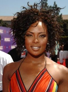 Sexy is one of those words that just exudes from the young and beautiful America's Top Model Eva Marcille who just looks amazing with her gorgeous natural kinky curls flowing all over the place in such a cool and laid back manner.