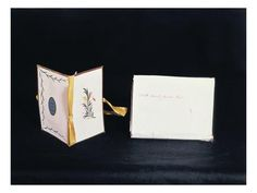 """A Needle Case given by Jane Austen to her niece Louisa Knight, now in the Jane Austen's House Museum in Chawton. This image shows the back, decorated with eaves for edging on three sides and an oval blue paper medallion iedged with a black scalloped border and printed with the words """"Esteem the Giver."""""""