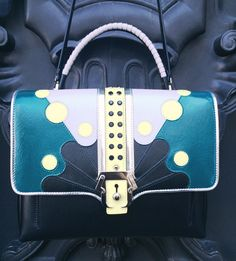 Ton-sur-ton: Paula Cademartori in patent leather with Andromeda inlay and crystal application, a must-have!  Shop here: http://bit.ly/1MEcAe2  ‪#‎fatimamendes‬ ‪#‎miss‬ ‪#‎paulacademartori‬ ‪#‎fw15‬