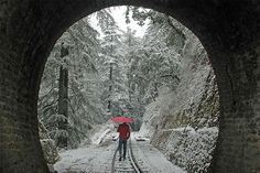 A man walks along a snow-covered railway track in Shimla, India's northern state of Himachal Pradesh. (AFP)