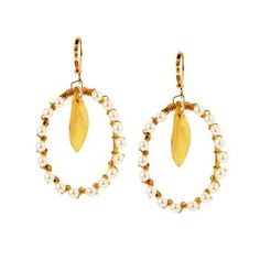 Pearl Leaf Earrings. In this nature-inspired earring, a golden leaf dangles from a Swarovski pearl wrapped oval. $150.00