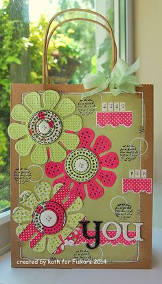 """I've got my Fiskars hat on again.sharing a """"Coffee Break"""" Project I made for this month's issue of Simply Cards and Papercraft . Creative Gift Wrapping, Creative Gifts, Paper Rosettes, Paper Flowers, Fuse Card, Decorated Gift Bags, Paper Bag Crafts, Recycled Plastic Bags, Book Page Crafts"""