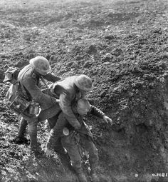"""WWI, Oct 1917;""""Fritz helps a Canadian to a Dressing Station."""" MIKAN no. 3397035 Library and Archives Canada"""
