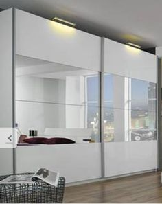 Google Image Result for http://www.simplybedrooms.com/product_images/tira%2520sliding%2520door%2520wardrobe%2520centre%2520mirrors%2520high%2520gloss%2520picture.jpg
