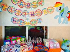 My Little Pony Rainbow Dash Birthday Banner. Used gift wrap and traced kitchen bowls on wrap. Cut out printed letters, glued them on, and personalized with ribbon and small rainbow dash pictures Rainbow Dash Birthday, 2nd Birthday, Goody Bags, My Little Pony, Circles, Turning, Bowls, Chevron, Banner