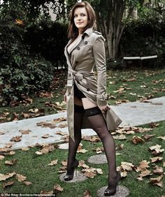 "Elisabeth Moss - Peggy from ""Mad Men"" in an overcoat and not much more."