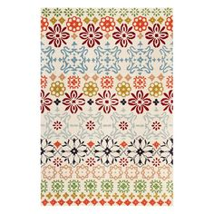 Hand-tufted wool rug with a floral motif. Product: RugConstruction Material: WoolColor: Ivory and mul...