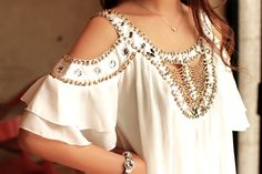 like the details and the shoulder cutouts and ruffled sleeves