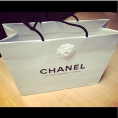 """Offers Welcome: 😻Chanel Original Shopping Bag (offers are welcome) Chanel Original Store White Shopping Bag. Has black handles and logo on both sides """"Chanel"""" with address of the original Chanel Store in Paris. Also has Camilla flower on one side of the bag.  It is from Paris, France. Measurements: approx. 16.6"""" length, approx. 6.9"""" width, approx. 13.2"""" height. Brand new. CHANEL Bags"""