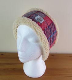 Harris Tweed Head Warmer.  http://www.ebay.co.uk/itm/Harris-Tweed-Head-Warmer-Headband-Pinks-and-Purples-/111776837985