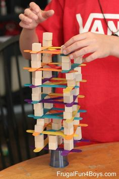 Fun engineering challenges for kids using cups, craft sticks, and wooden blocks. Great for STEM skills!